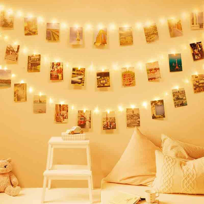 colgar fotos con pinzas y luces